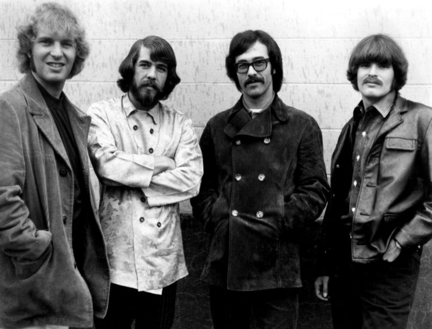 Black and white photo of the four members of Creedence Clearwater Revival.